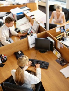 businessman and two businesswomen working in an office