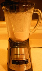 photo of Blender with almond milk and chocolate pizzelle smoothie mixture