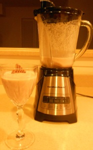 photo of glass of Chocolate Cookie Milk Smoothie and blender