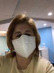 Jennifer Garcia wearing face mask to protect against COVID-19.