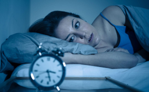 picture of woman having difficulty sleeping