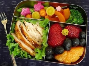photo of balanced, healthy lunch grilled chicken, vegetables and fruit